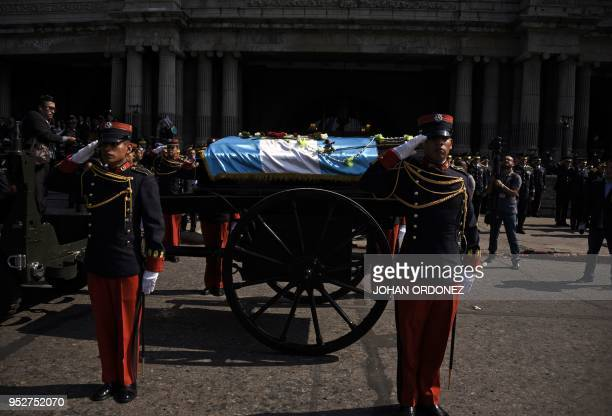 TOPSHOT The fragdraped coffin of Guatemala City Mayor and former Guatemalan President Alvaro Arzu is escorted by military personnel during his...