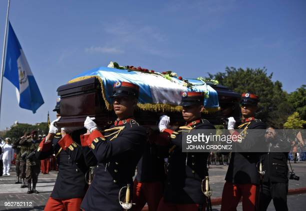 The fragdraped coffin of Guatemala City Mayor and former Guatemalan President Alvaro Arzu is escorted by military personnel during his funeral as...