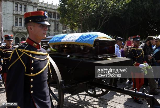 The frag-draped coffin of Guatemala City Mayor and former Guatemalan President Alvaro Arzu is escorted by military personnel during his funeral as...