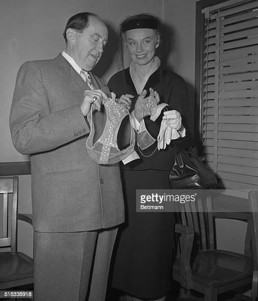 The frail items in the hands of lawyer Jerry Giesler are A and B panties and bra respectively in a court case involving nightclub performer Lili St...