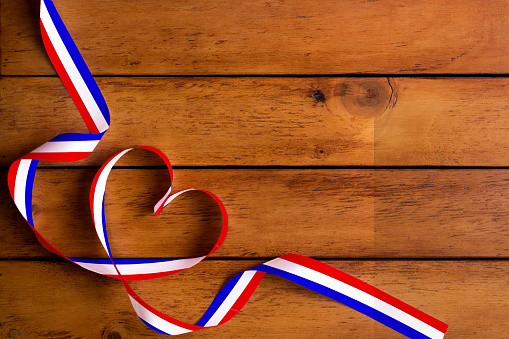 The France flag pattern and heart-shaped ribbon on wooden table/Bastille day 812563052