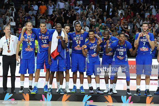 The France National Team celebrates after defeating the Lithuania National Team in the 2014 FIBA World Cup Third Place game at Palacio de Deportes on...