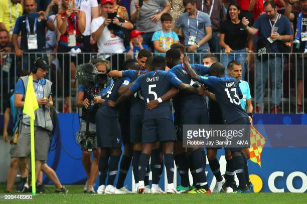 The France players celebrate after Mario Mandzukic of Croatia scored an own goal to make it 10 during the 2018 FIFA World Cup Russia Final between...