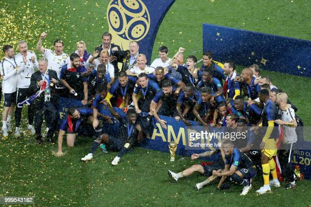 The France players celebrate with the World Cup Trophy following their sides victory in the 2018 FIFA World Cup Final between France and Croatia at...