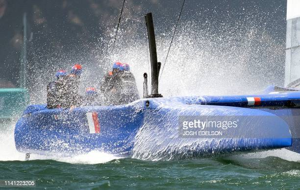 TOPSHOT The France SailGP team splashes down in their F50 catamaran during the SailGP races on the San Francisco Bay in San Francisco California on...