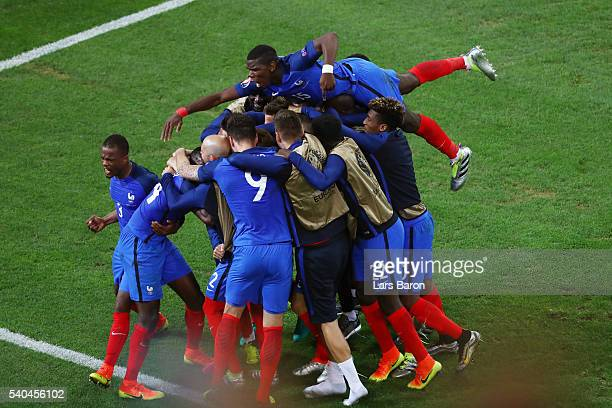 The France squad celebrate with Dimitri Payet of France after he scored his sides second goal during the UEFA EURO 2016 Group A match between France...
