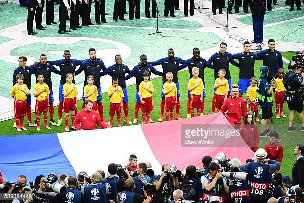 The France team during their national anthem before the GroupA preliminary round match between France and Romania at Stade de France on June 10 2016...
