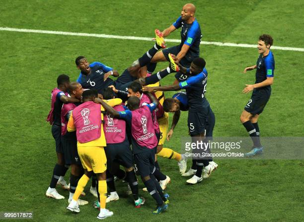 The France team lift Paul Pogba of France as they celebrate winning the World Cup during the 2018 FIFA World Cup Russia Final between France and...
