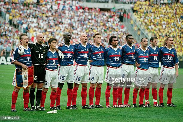 The France team lines up for the national anthem prior to the 1998 FIFA World Cup final against Brazil. France won 3-0. | Location: Saint Denis,...