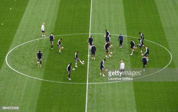 The France team warm up in the centre circle during a training session at Saint Petersburg Stadium on July 9 2018 in Saint Petersburg Russia