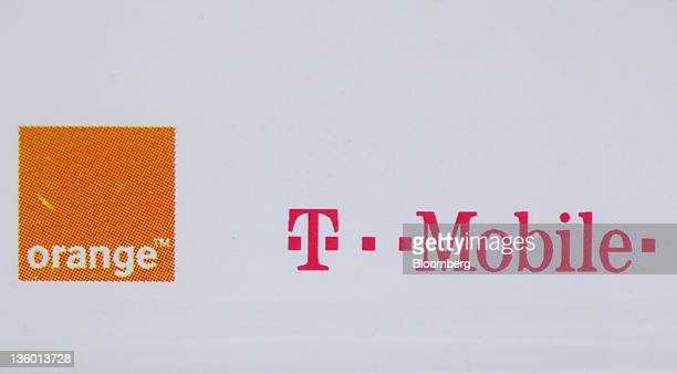 The France Telecome SA's Orange brand logo left and the Deutsche Telekom AG's TMobile brand logo are displayed on a sales ticket at a store operated...