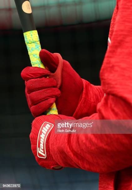 The Franklin batting gloves worn by Cesar Hernandez of the Philadelphia Phillies before a game against the Miami Marlins at Citizens Bank Park on...