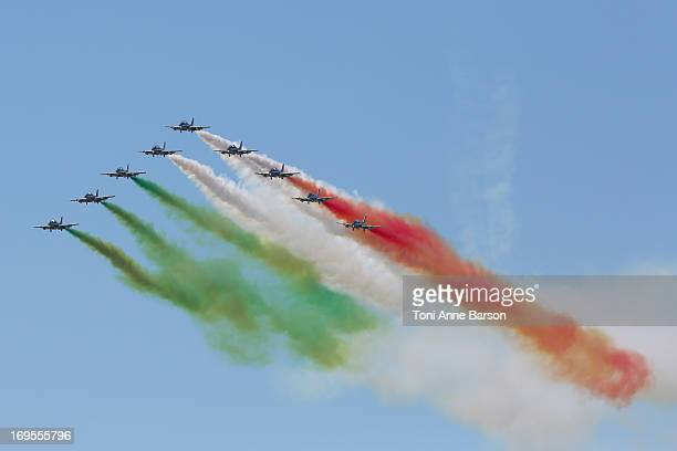 The Frecce Tricolori demonstration flight during the 60th Anniversary Celebration of The Patrouille de France the legendary French flight...