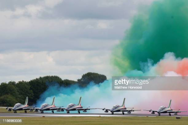 The Frecce Tricolori of the Italian Air Force perform during the International Air Tattoo at RAF Fairford on July 21 2019 in Fairford England The...