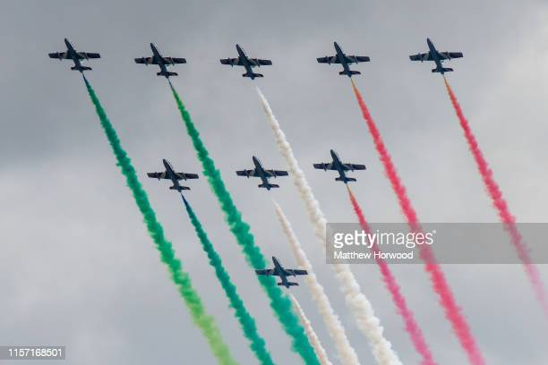 The Frecce Tricolori of the Italian Air Force performs during the International Air Tattoo at RAF Fairford on July 21, 2019 in Fairford, England. The...