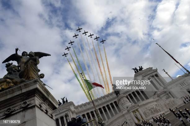 The Frecce Tricolori, the aerobatic demonstration team of the Italian Aeronautica Militare, fly over the Altare della Patria in Rome on April 22 as...