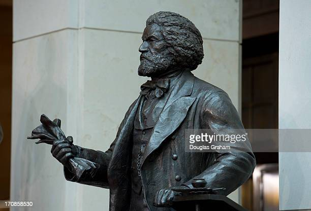 The Fredrick Douglass statue sits in the Emancipation Hall in the Capitol Visitors Center of the US Capitol during a dedication ceremony on June 19...