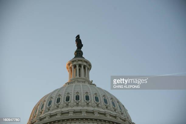 The Freedom Statue sit on top of the US CApitol ptior to US President Barack Obama delivering a speech to a joint session of Congress on February 24...