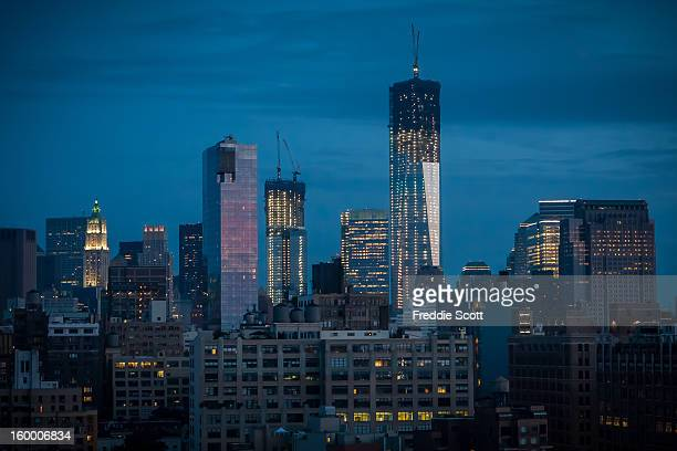 The Freedom Tower is about 2/3rds complete in this shot. This is during a sunset, view from a nearby rooftop.