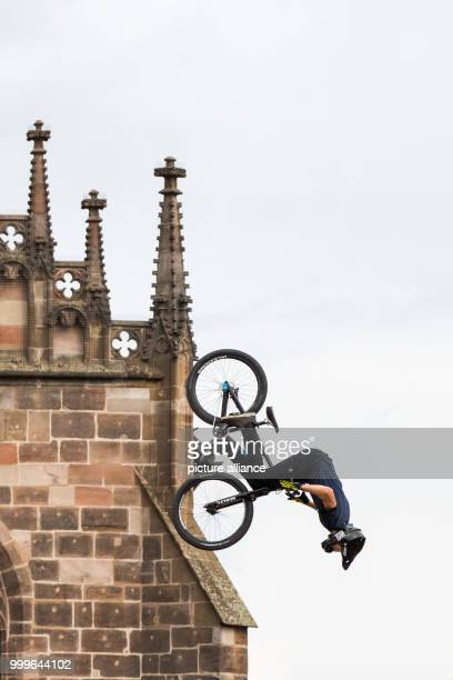 The freestyle mountain biker Jakub Vencl from the Czech Republic jumps in front of a backdrop of the Frauenkirche during the finals of the 'Red Bull...