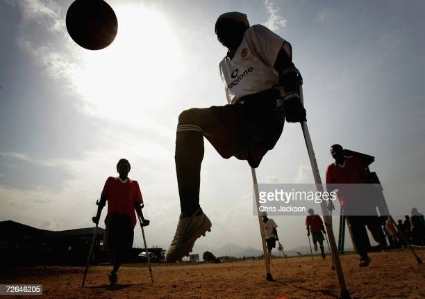 The Freetown Single Limb Amputee football team practice on Lumley Beach on November 26 2006 in Freetown Sierra Leone Nearly all the players were...