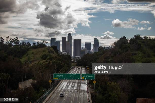 TOPSHOT The Freeway 110 is pictured with downtown Los Angeles California on March 19 2020 All residents of California were ordered to stay at home...