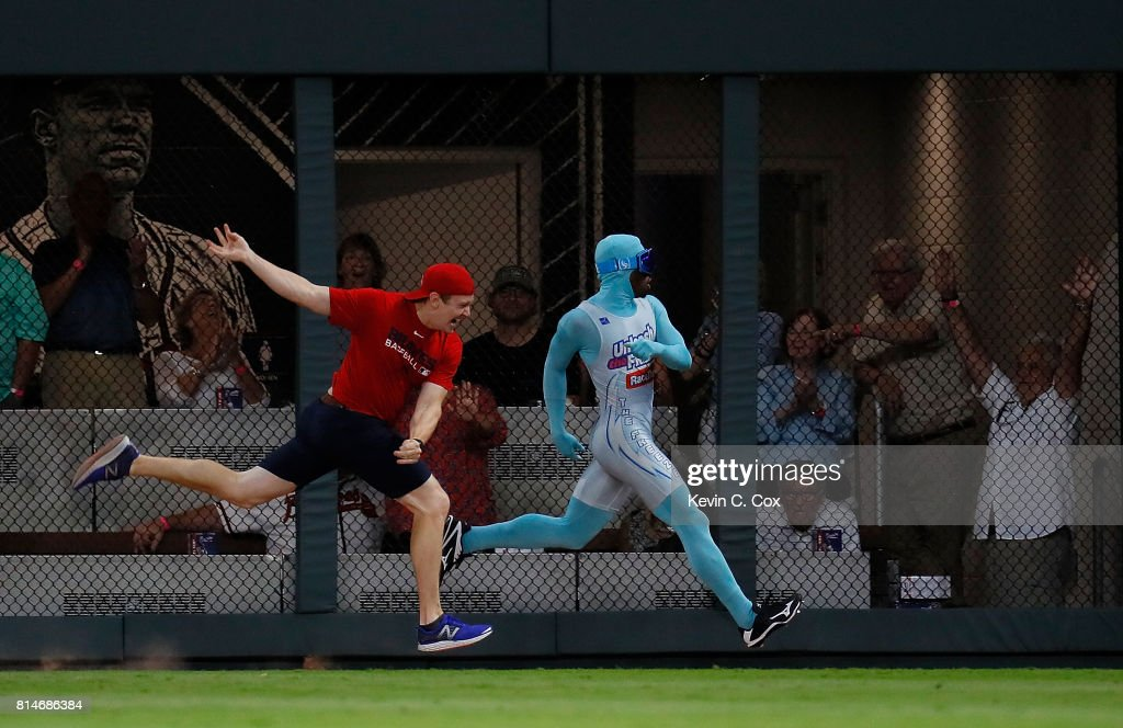The Freeze defeats a fan in a race during the middle of the fifth inning of the game between the Atlanta Braves and the Arizona Diamondbacks at SunTrust Park on July 14, 2017 in Atlanta, Georgia.