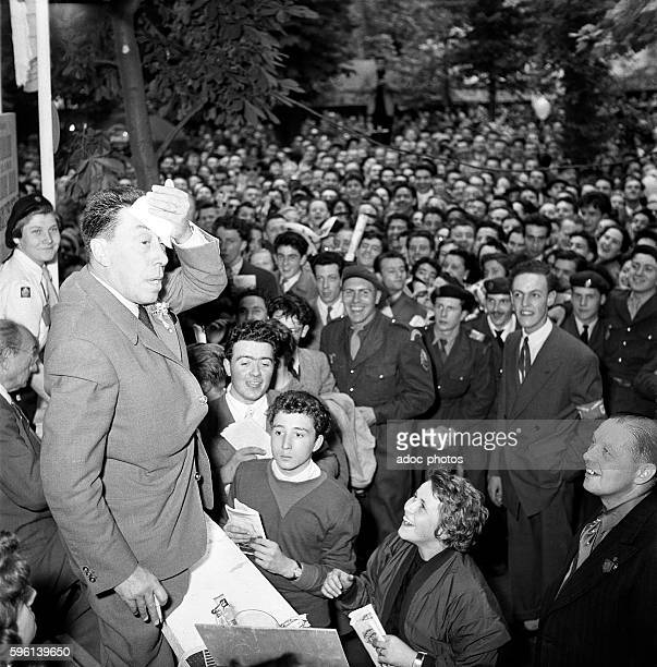 The French actor and singer Fernandel at the funfair 'Kermesse aux étoiles' in Paris In 1957