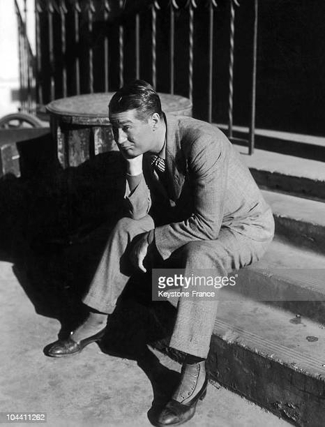 """The French actor and singer Maurice CHEVALIER in Los Angeles on August 22, 1933. CHEVALIER is shooting the film """"Les Chemins de l'Amour"""" with the..."""
