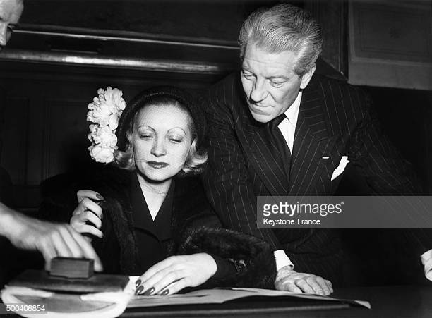 The French actor Jean Gabin marrying his third wife, Christiane Fournier, called Dominique, at the city hall of the XVIth arrondissement, signing the...