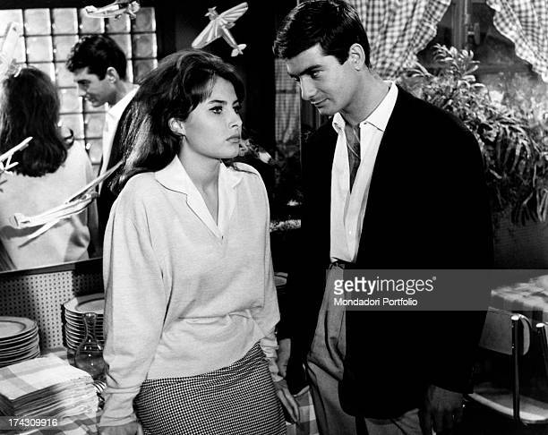 The French actor JeanClaude Brialy playing the leading role of Jacky in Deray's The gigolo stands within a little restaurant looking into the eyes of...