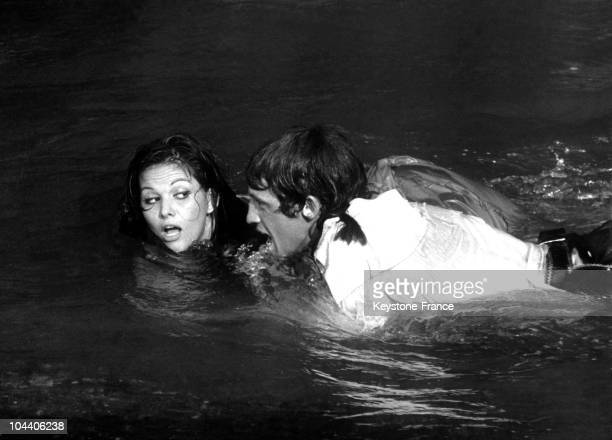 The French actor JeanPaul BELMONDO and the Italian actress Claudia CARDINALE are playing a scene from Philippe DE BROCA's film CARTOUCHE Chased by...
