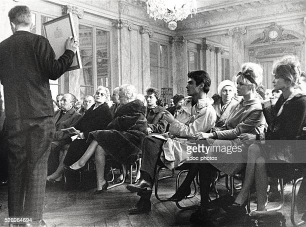 The French actors Brigitte Bardot and Samy Frey during an auction at Versailles In 1962