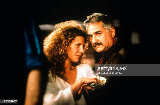 The French actors Solveig Dommartin and JeanClaude Brialy are close with a bunch of banknotes on the set of No Fear No Die a Claire Denis movie about...