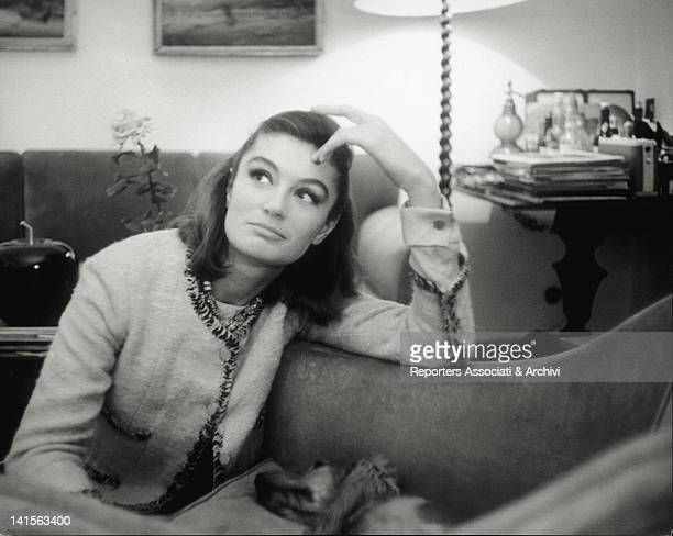 The French actress Anouk Aimée photographed in the living room of her new Rome house. Rome, 2nd December 1963.