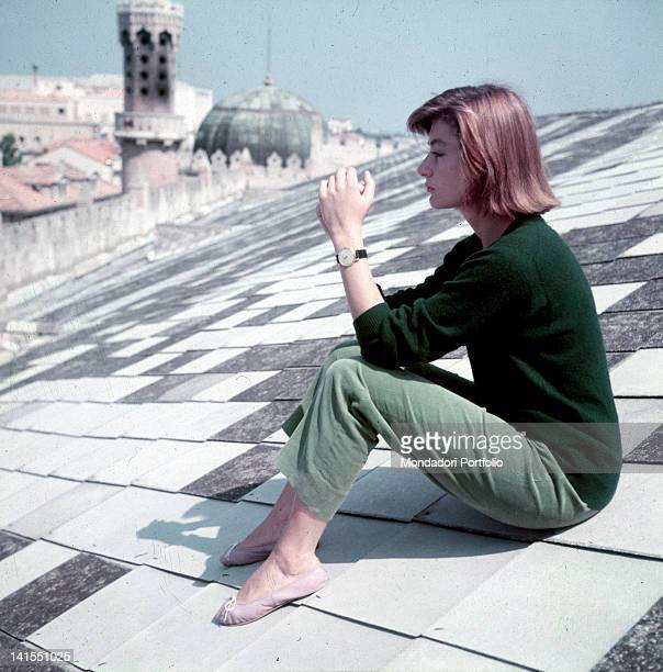 The French actress Anouk Aimee sitting on the Hotel Excelsior roof. Venice, 1955