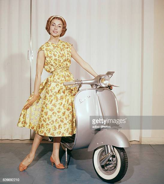 The French actress Fabienne posing in an advertisement for Vespa scooters In 1955