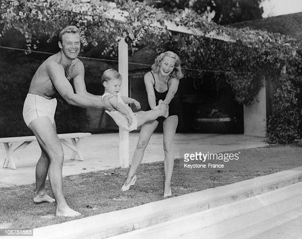 The French Actress Michele Morgan With Her Husband The American Actor Bill Marshall And Their Son Michael Then Ages 2 At Their Beverly Hills Home In...