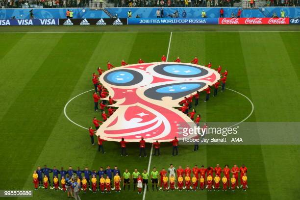 The French and Belgium national sides line up for the national anthems before their World Cup Semi Final match during the 2018 FIFA World Cup Russia...