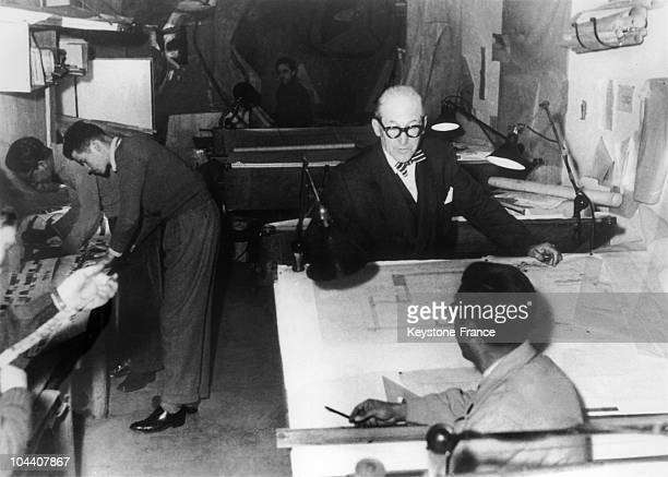 The French architect LE CORBUSIER in his workroom on rue de Sevres in Paris alongside his students and collaborators in the 1950's
