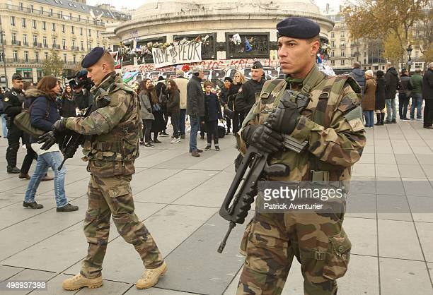 The French army patrol at the 'Place de la Republique' as the public gather in memory of the 130 victims of the Paris terrorist attacks on November...