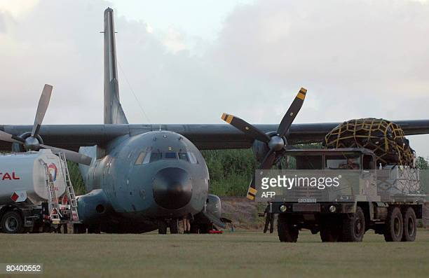 The French army transport plane which transported Anjouan leader Mohamed Bacar is seen on March 27 2008 at the airport in Pamandzi Petite Terre...