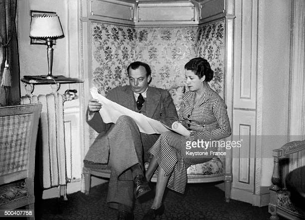 The French aviator Antoine de SaintExupery relaxing in his Paris apartment with his wife Consuelo Gomez Carillo de Saint Exupery The aviator had just...