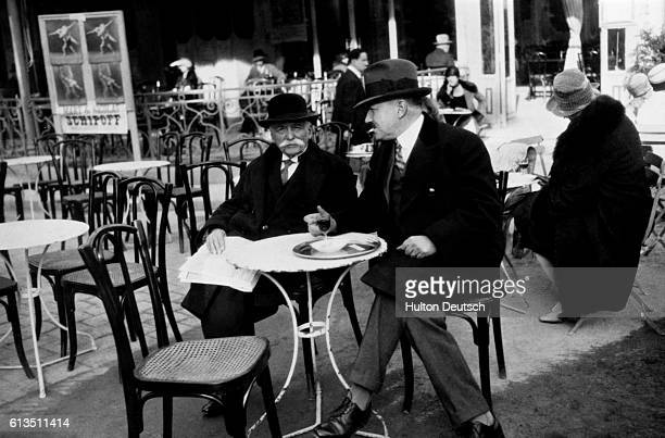 The French Chef Auguste Escoffier sits in front of a Paris cafe with a friend ca 1925