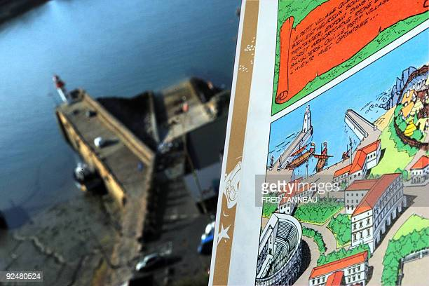 AGNIEL The French comic book Le domaine des dieux representing the harbour of the village of Asterix and Obelix characters from Gaul is held over the...