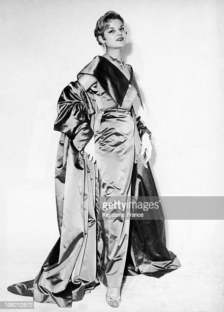 The French Couturier Pierre Clarence Presenting An Evening Dress Made From Emerald Green Satin Called Denfert