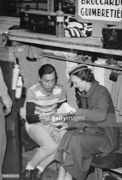 The French cyclist Marcel Guimbretiere with his fiancée Six Days race in the Vélodrome d'Hiver 22th March 1935 Photograph