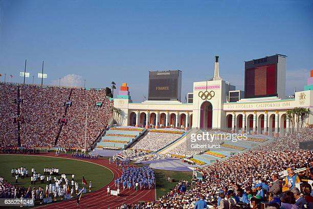 The French delegation marches into Coliseum Stadium during the opening ceremony of the Los Angeles 1984 Olympic Games