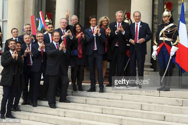 The french delegation poses before the ceremony to celebrate the Olympic Games 2024 in Paris at Elysee Palace on September 15 2017 in Paris France...