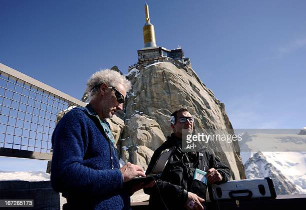 The French director of the Mountain Medical Research and Training Institute Emmanuel Cauchy tests a volunteer on April 17 2013 at the top of the 3800...